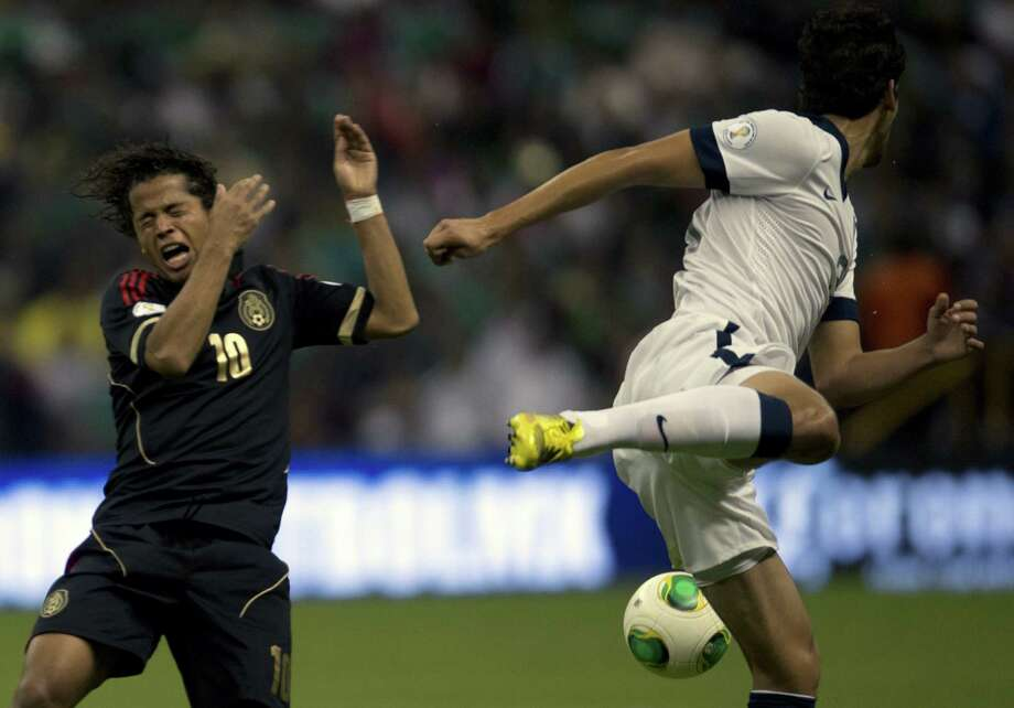 Mexico's forward Giovani Do Santos disputes the ball with Omar Gonzalez of the U.S. Photo: YURI CORTEZ, AFP/Getty Images / YURI CORTEZ