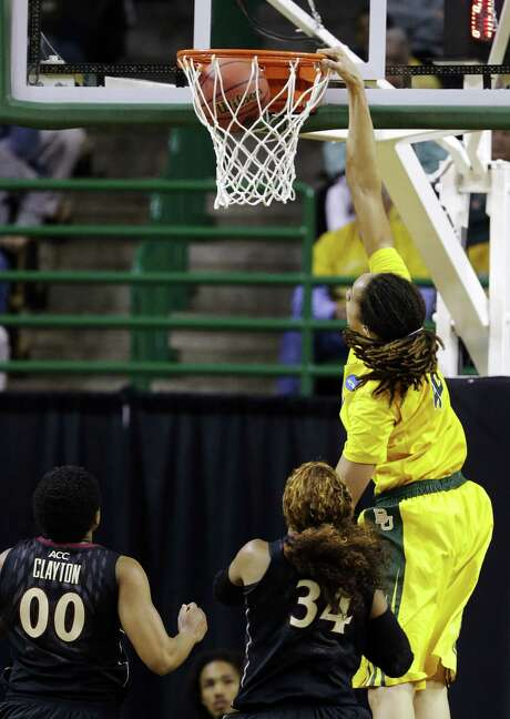 Baylor's Brittney Griner throws down one of her three dunks Tuesday against Florida State. She scored 33 points and grabbed 22 rebounds. Photo: Tony Gutierrez / Associated Press