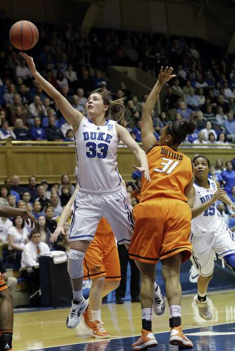 Duke's Haley Peters shoots past Oklahoma State's Kendra Suttles in the Blue Devils' victory. Photo: Gerry Broome / Associated Press