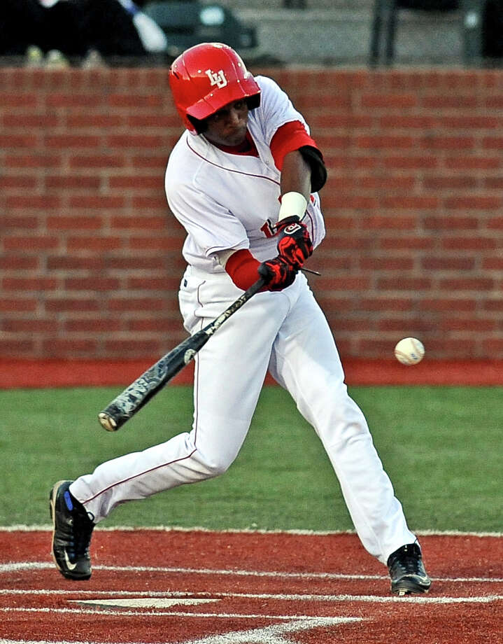 Lamar player Sam Bumpers, #9, connects with the ball during the Lamar University baseball game against the University of Houston on Tuesday, March 26, 2013, at Lamar University. Photo taken: Randy Edwards/The Enterprise Photo: Randy Edwards