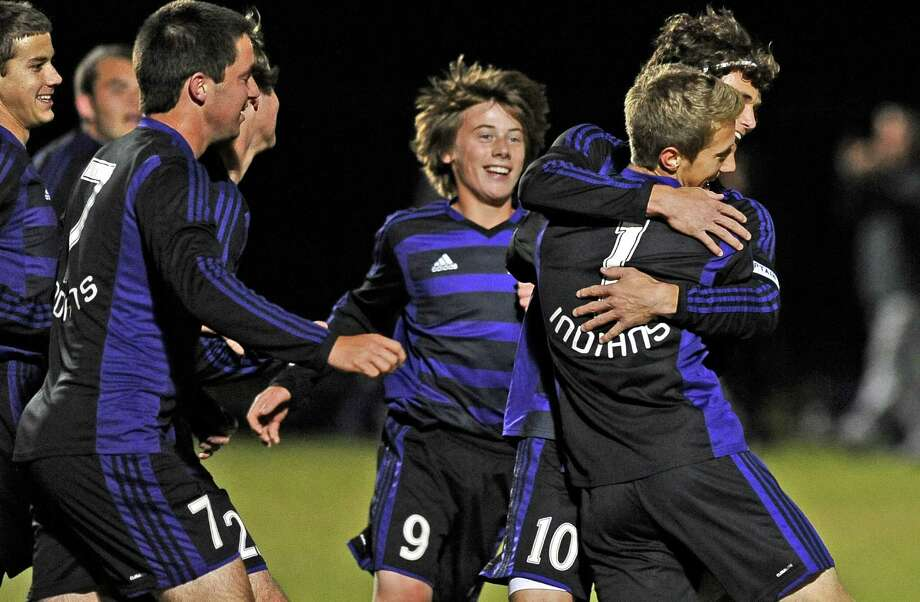PN-G player Hayden Hoffpauir, #1, celebrates with his teammates after their first goal in the first period of the Port Neches-Groves High School bidistrict round of boys soccer against Lumberton High School on Tuesday, March 26, 2013, at Lamar University. Photo taken: Randy Edwards/The Enterprise Photo: Randy Edwards