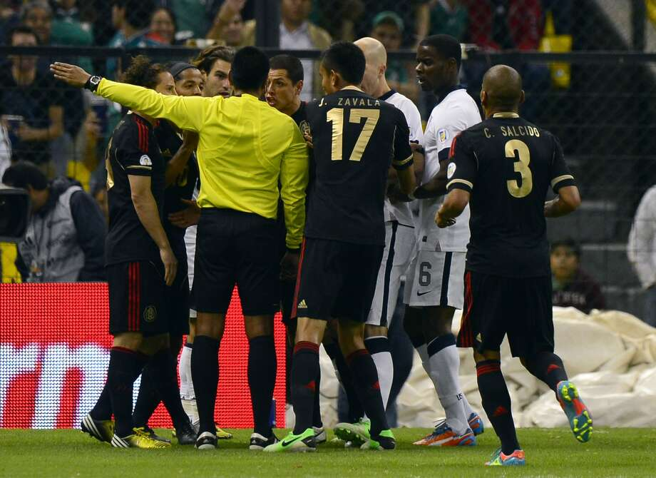 Players of Mexico argue with the referee after their FIFA World Cup Brazil 2014 qualifying match against the US at the Azteca stadium in Mexico City, on March 26, 2013. The match ended in a 1-1 tie. AFP PHOTO/Alfredo EstrellaALFREDO ESTRELLA/AFP/Getty Images Photo: ALFREDO ESTRELLA, AFP/Getty Images / AFP