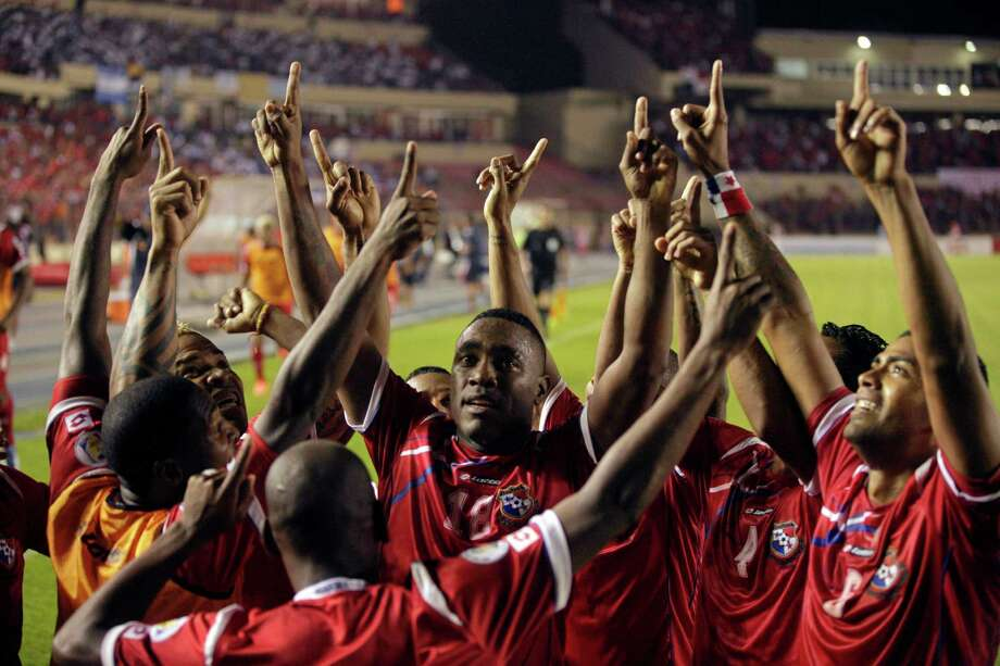 Panama's Luis Tejada, center, celebrates with teammates after scoring against Honduras during a World Cup 2014 qualifying soccer match in Panama City, Tuesday, March 26, 2013. (AP Photo/Arnulfo Franco) Photo: Arnulfo Franco, Associated Press / AP