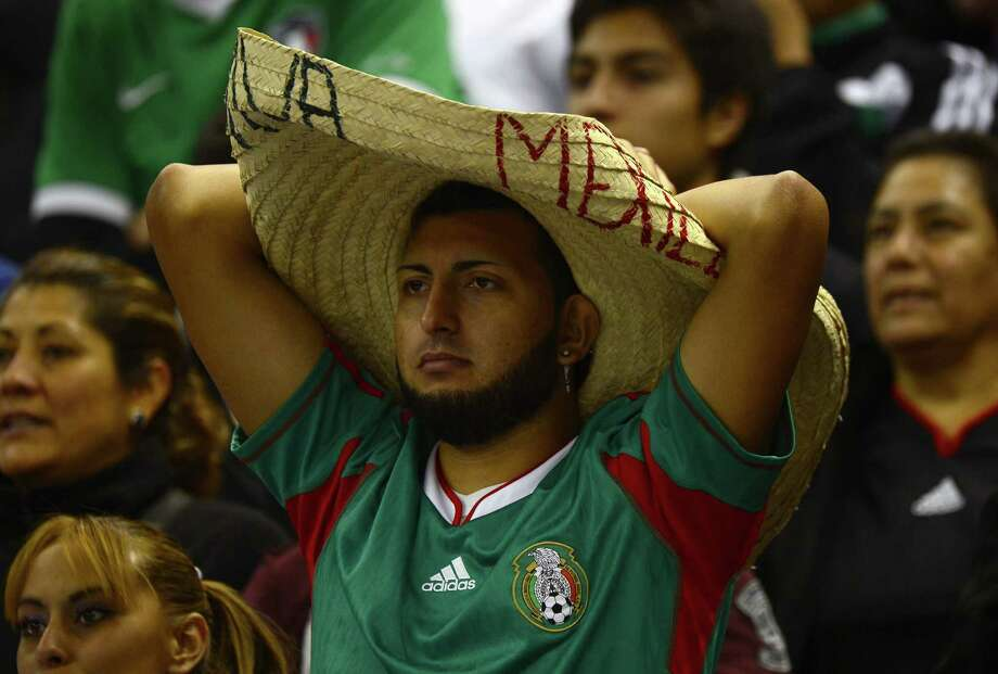 Mexico´s fans watch the FIFA World Cup Brazil 2014 qualifying match against the US at the Azteca stadium in Mexico City, on March 26, 2013. The match ended in a 1-1 tie. AFP PHOTO/Alfredo EstrellaALFREDO ESTRELLA/AFP/Getty Images Photo: ALFREDO ESTRELLA, AFP/Getty Images / AFP
