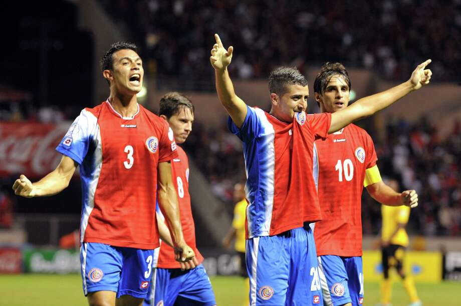 Costa Rica's Giancarlo Gonzalez (L) Diego Calvo  (C) and Bryan Ruiz (R) celebrate their second goal  during their FIFA World Cup Brazil 2014 qualifying footblall match at  the National Stadium in San Jose, on March 26 , 2013. AFP PHOTO / Ezequiel BECERRAEZEQUIEL BECERRA/AFP/Getty Images Photo: EZEQUIEL BECERRA, AFP/Getty Images / AFP