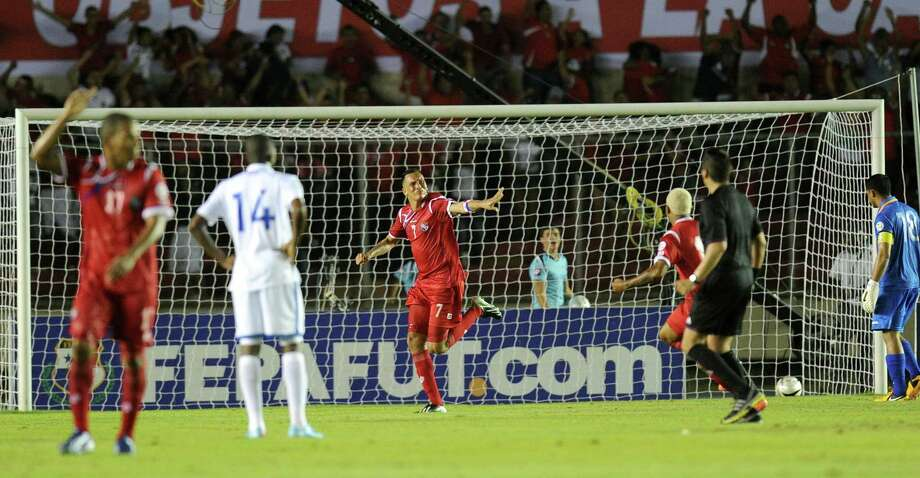 Panama's Blas Perez (C) celebrate after scoring against Honduras during their FIFA World Cup Brazil 2014 qualifier football match at the Rommel Fernandez Stadium in Panama City on March 26, 2013.AFP PHOTO/ Rodrigo ARANGUARODRIGO ARANGUA/AFP/Getty Images Photo: RODRIGO ARANGUA, AFP/Getty Images / AFP