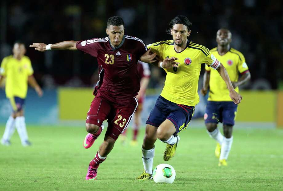 Venezuelan forward Jose Rondon (L) vies for the ball with Colombian midfielder Abel Aguilar during a Brazil 2014 World Cup qualifier football match at Cachamay stadium in Puerto Ordaz, Venezuela on March 26, 2013. AFP PHOTO/Nelson PulidoNelson Pulido/AFP/Getty Images Photo: NELSON PULIDO, AFP/Getty Images / AFP