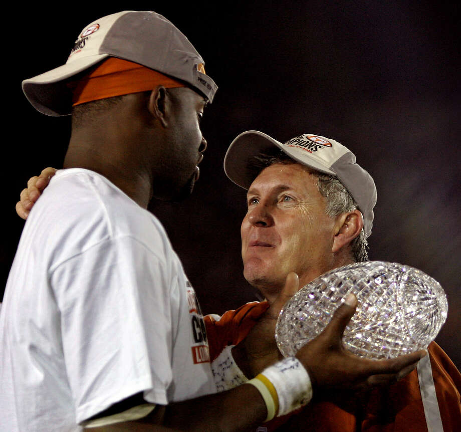 Texas quarterback and game MVP Vince Young holds the championship trophy with coach Mack Brown, right, after Texas beat Southern California 41-38 in the Rose Bowl, the national championship college football game in Pasadena, Calif., Wednesday, Jan. 4, 2006. (AP Photo/Chris Carlson) Photo: CHRIS CARLSON, Associated Press / AP