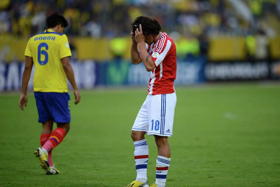 Paraguayan forward Nelson Haedo (R) reacts in dejection after the FIFA World Cup Brazil 2014 South American qualifying football match against Ecuador in Quito, Ecuador on March 26, 2013. Ecuador won the match by 4 -1. AFP PHOTO / Rodrigo BuendiaRODRIGO BUENDIA/AFP/Getty Images Photo: RODRIGO BUENDIA, AFP/Getty Images / AFP