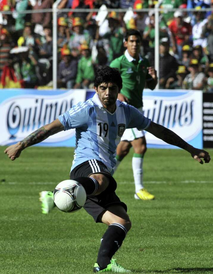 Argentina's Ever Banega kicks the ball during their Brazil 2014 FIFA World Cup South American qualifier football match against Bolivia, at the Hernando Siles stadium in La Paz, on March 26, 2013.  AFP PHOTO / AIZAR RALDESAIZAR RALDES/AFP/Getty Images Photo: AIZAR RALDES, AFP/Getty Images / AFP