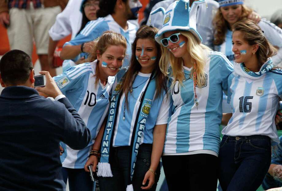 Argentina fans pose for a picture before the start of a World Cup 2014 qualifying soccer match against Bolivia in La Paz, Bolivia, March 26, 2013. (AP Photo/Juan Karita) Photo: Juan Karita, Associated Press / AP