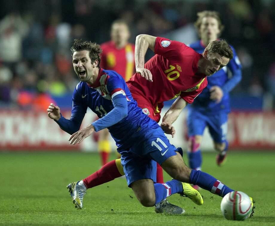 Darijo Srna of Croatia (L) vies with Andy King of Wales (R) during the FIFA 2014 World Cup qualifying football match between Wales and Croatia at Liberty Stadium in Swansea, south Wales, on March 26, 2013. Croatia won the game 2-1. AFP PHOTO/ADRIAN DENNISADRIAN DENNIS/AFP/Getty Images Photo: ADRIAN DENNIS, AFP/Getty Images / AFP