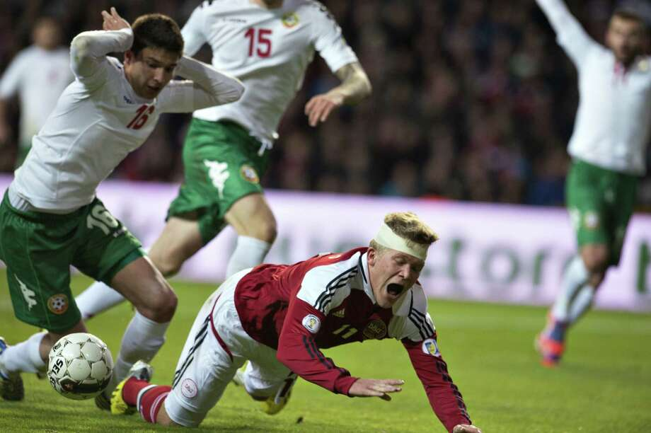 Denmark 's Andreas Cornelius (R) vies with Bulgaria 's Iliya Milanov during their 2014 World Cup qualifying football match at Parken Stadium in Copenhagen on March 26, 2013. AFP PHOTO / SCANPIX SENMARK / Jens NorgaardJens Nørgaard Larsen/AFP/Getty Images Photo: JENS NØRGAARD LARSEN, AFP/Getty Images / AFP