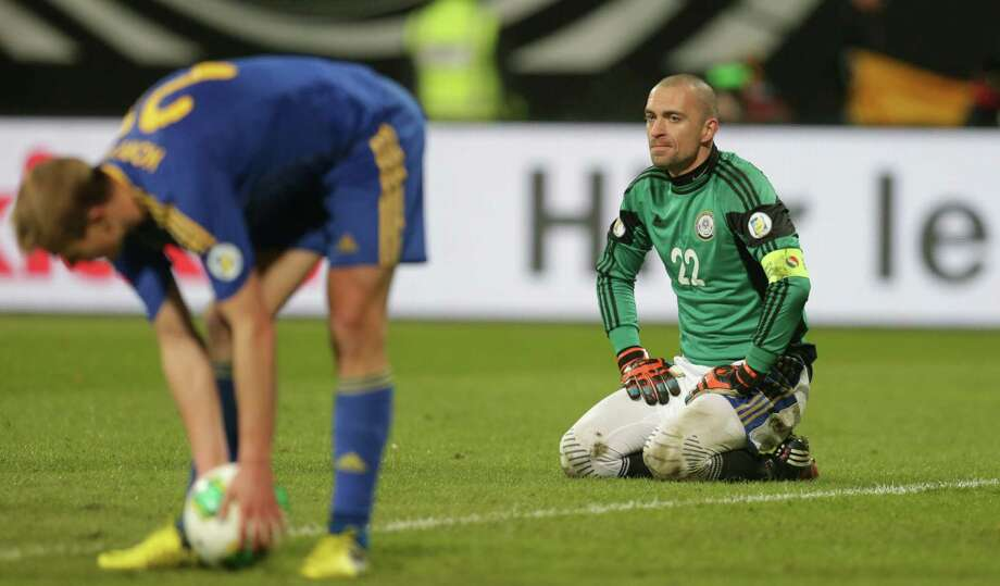 Kazakhstan's goalkeeper Andrey Sidelnikov reacts after Germany's Marco Reus scored his side's fourth goal during their World Cup Group C qualifying soccer match in Nuremberg, southern Germany, on Tuesday, March 26, 2013. (AP Photo/Matthias Schrader) Photo: Matthias Schrader, Associated Press / AP