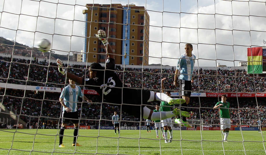 Bolivia's goalkeeper Sergio Galarza, center, clears a shot by Argentina's Rodrigo Palacio (16) during a 2014 World Cup qualifying soccer game in La Paz, Bolivia, Tuesday, March 26, 2013. (AP Photo/Martin Mejia) Photo: Martin Mejia, Associated Press / AP