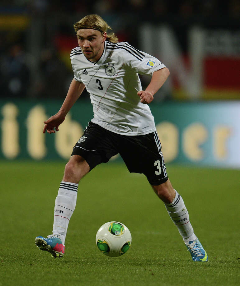 German defender Marcel Schmelzer controls the ball during the Germany vs Kazakhstan FIFA 2014 World Cup qualifying football match in Nuremberg, on March 26, 2013.  AFP PHOTO / PATRIK STOLLARZPATRIK STOLLARZ/AFP/Getty Images Photo: PATRIK STOLLARZ, AFP/Getty Images / AFP
