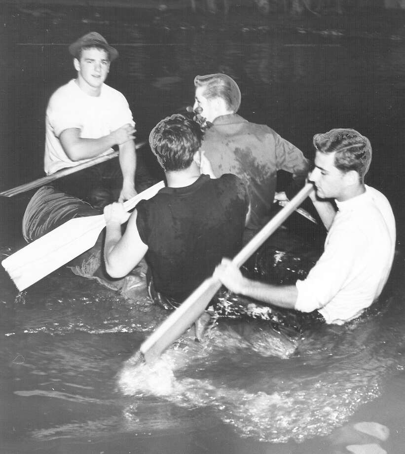 Fiesta River Parade 1959: These guys were taking over the show around the Arneson River Theater. They are in a rubber raft but it stayed mostly under water most of the time. Photo: San Antonio Express-News File Photo