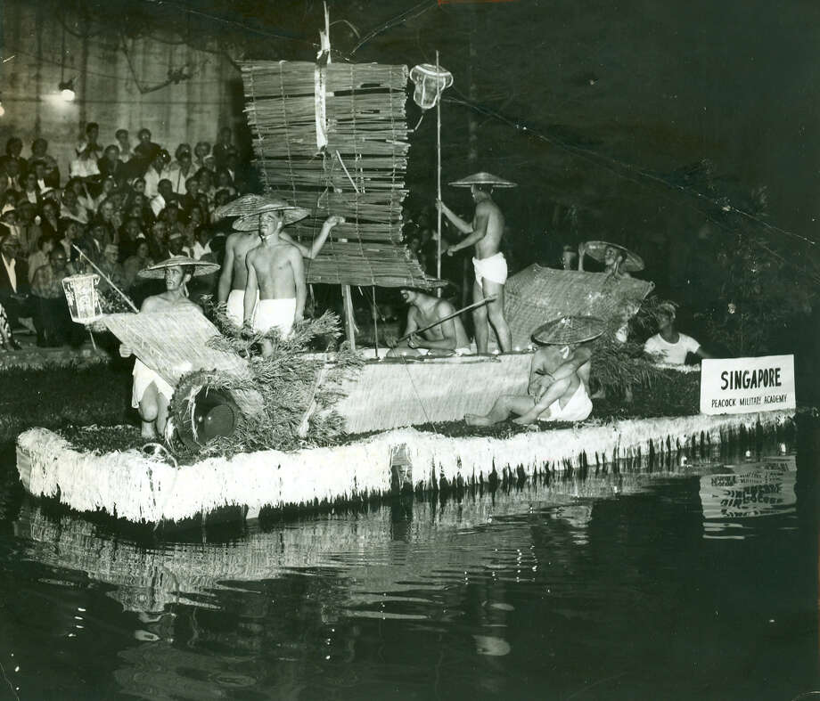 Fiesta River Parade 1958: Singapore is the theme of this float from the Peacock Military Academy. Photo: San Antonio Express-News File Photo