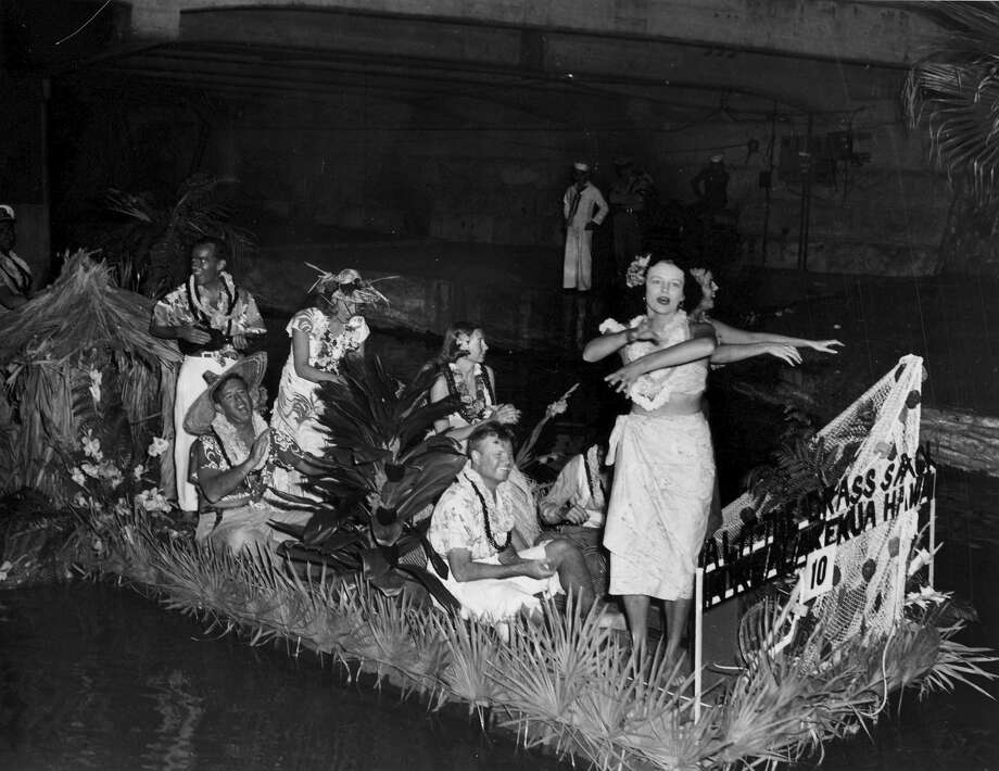 Fiesta River Parade 1949: A Hawaiian-themed float travels the parade route. Photo: San Antonio Express-News File Photo