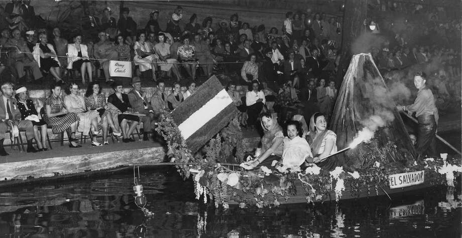 Fiesta River Parade 1947: A smoking volcano is a feature of the float representing El Salvador in the Pan-American River Pageant on the opening night of the 52nd Fiesta de San Jacinto. The float was sponsored by the Ursuline Academy and was one of 17 depicting Pan-American nations. Photo: San Antonio Express-News File Photo