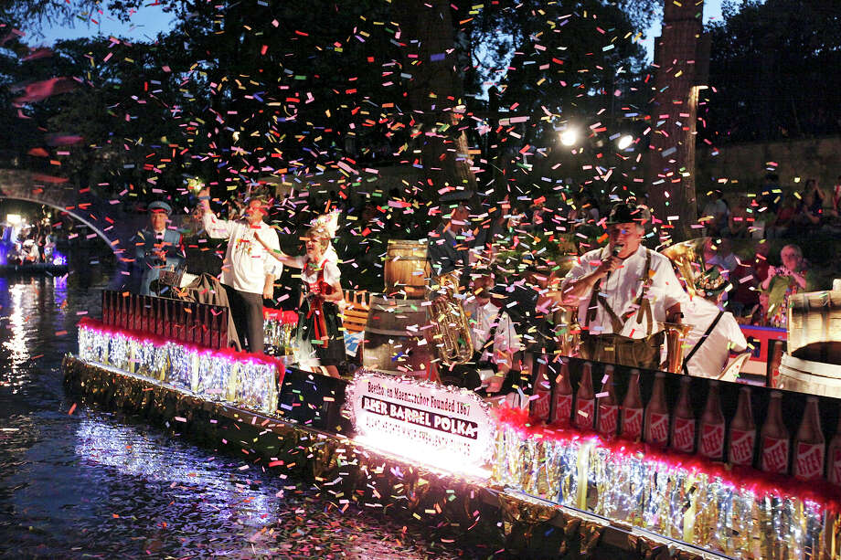 "Fiesta River Parade 2012: Confetti fills the air as Beethoven Maennerchor's ""Beer Barrel Polka"" float passes. Photo: Edward A. Ornelas / San Antonio Express-News / SAN ANTONIO EXPRESS-NEWS (NFS)"