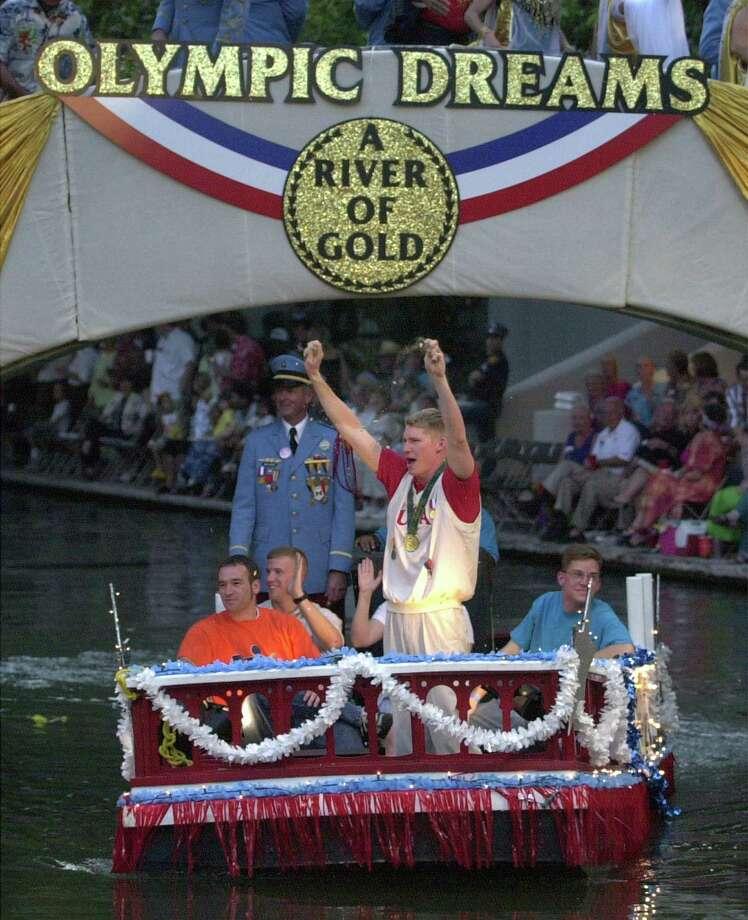 Fiesta River Parade 2000: Grand Marshal Olympian Josh Davis welcomes the crowd. Photo: San Antonio Express-News File Photo / SAN ANTONIO EXPRESS-NEWS