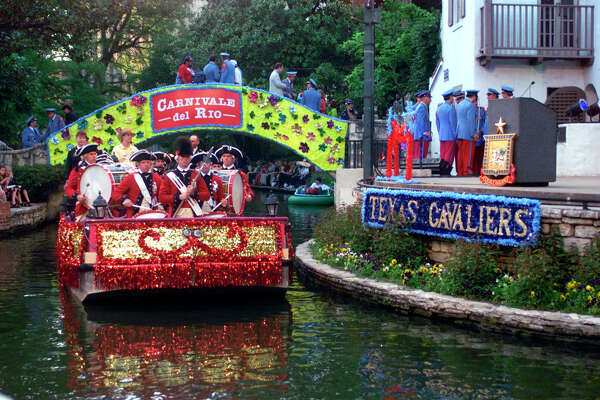 Fiesta River Parade 1999:  A float carrying a band passes through the Arneson River Theater.