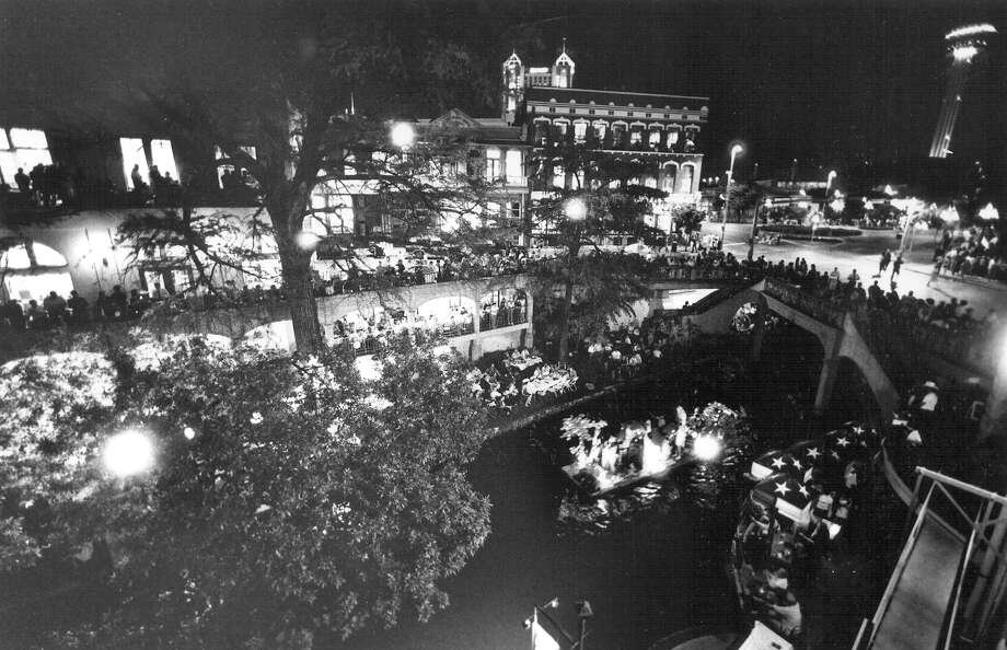 Fiesta River Parade 1993: A barge emerges from Commerce Street Bridge. Photo: San Antonio Express-News File Photo