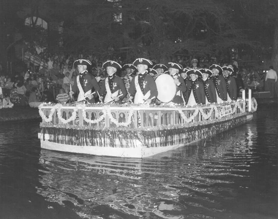 Fiesta River Parade 1990: The Old Guard Fife and Drum Corps floats the parade route. Photo: San Antonio Express-News File Photo