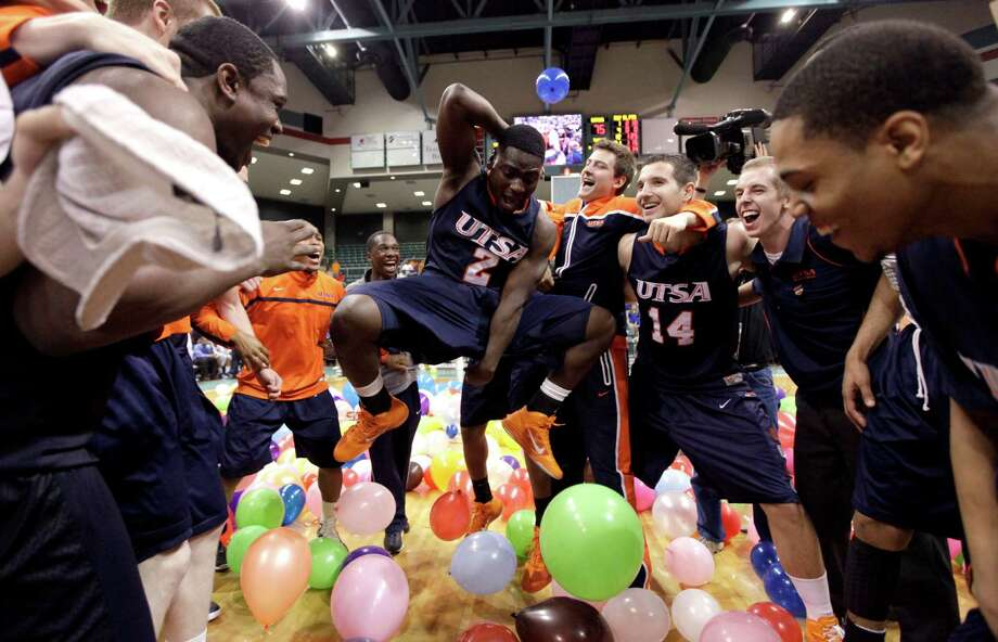16. 2011 UTSA: Kalif Bakare (2) celebrates with teammates after defeating McNeese State 75-72 in the Southland Conference tournament championship on March 12, 2011, in Katy. Photo: David J. Phillip, Associated Press / Copyright: AP