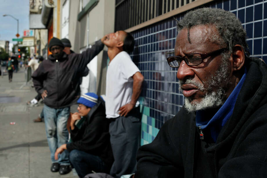 Clarence Perkins, 60, waits along Ellis Street with many other older homeless people for Tenderloin soup kitchens to open.  I turned 60 across the street on that sidewalk, said Perkins. Photo: Lacy Atkins, The Chronicle / ONLINE_YES