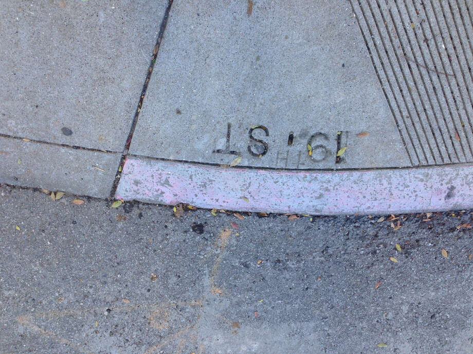 Vigilante sidewalk amelioration abounds in Noe Valley. I like to imagine some renegade took to the streets with a sharp scratchy object in a fit of pent-up rage after months of walking past the same ''19. ST'' on the way to work. Now he/she sighs with relief, knowing all is right with this little corner of the world. At 19th and Noe streets.