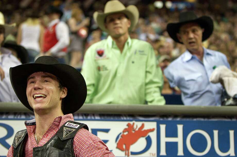 Beau Schroeder smiles after his ride in the Super Series Championship Bull Riding at the Houston Livestock Show and Rodeo on Saturday, March 17, 2012, in Houston. Schroeder won the championship in the event. (Smiley N. Pool / Houston Chronicle ) Photo: Chronicle