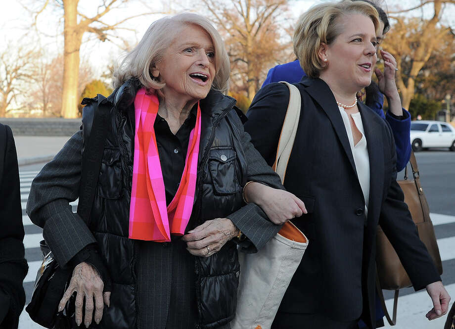 Plaintiff Edie Windso, an 83-year-old lesbian who was ordered to pay federal inheritance tax of $363,000 following the death of her partner of more than 40 years in 2009, arrives with her lawyer Roberta Kaplan (R) at the Supreme Court on March 27, 2013 in Washington, DC, for the US v. Windsor case challenging the constitutionality of Section 3 of the Defense of Marriage Act (DOMA). The rights of married same-sex couples will come under scrutiny at the US Supreme Court on Wednesday in the second of two landmark cases being considered by the top judicial panel. After the nine justices mulled arguments on a California law that outlawed gay marriage on Tuesday, they will take up a challenge to the legality of the Defense of Marriage Act (DOMA). The 1996 law prevents couples who have tied the knot in nine states -- where same-sex marriage is legal -- from enjoying the same federal rights as heterosexual couples. Photo: JEWEL SAMAD, AFP/Getty Images / 2013 AFP