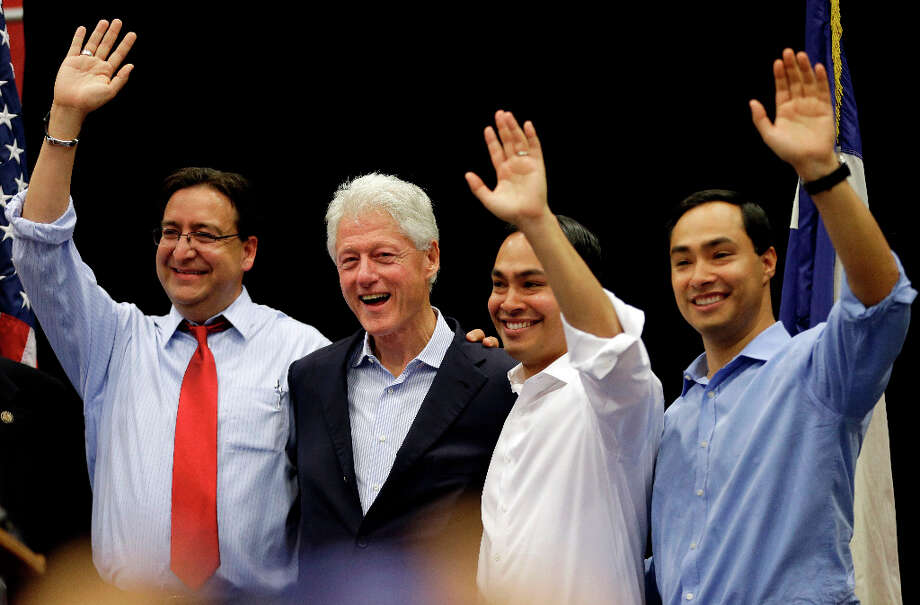 Former President Bill Clinton, second from left, stands with fellow democrats State Rep. Pete Gallego, D-Alpine, left, San Antonio Mayor Julian Castro, and U.S. congressional hopeful Joaquin Castro, right, during a campaign rally, Thursday, Oct. 25, 2012, in San Antonio. (AP Photo/Eric Gay) Photo: Eric Gay, Associated Press / AP