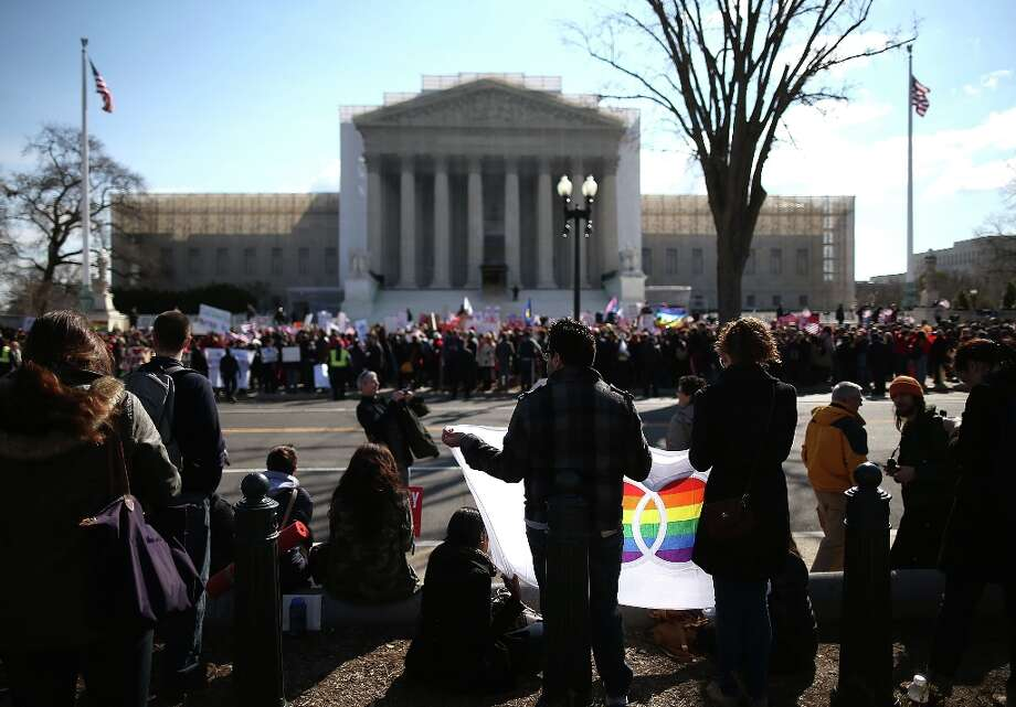 WASHINGTON, DC - MARCH 27:  People from both sides of the same-sex marriage issue gather in front of the U.S. Supreme Court, on March 27, 2013 in Washington, DC. Today the high court is hearing arguments on the constitutionality of the Defense of Marriage Act (DOMA), which withholds federal benefits from legally wed gay couples by defining marriage as only between a man and a woman. Photo: Mark Wilson, Getty Images / 2013 Getty Images