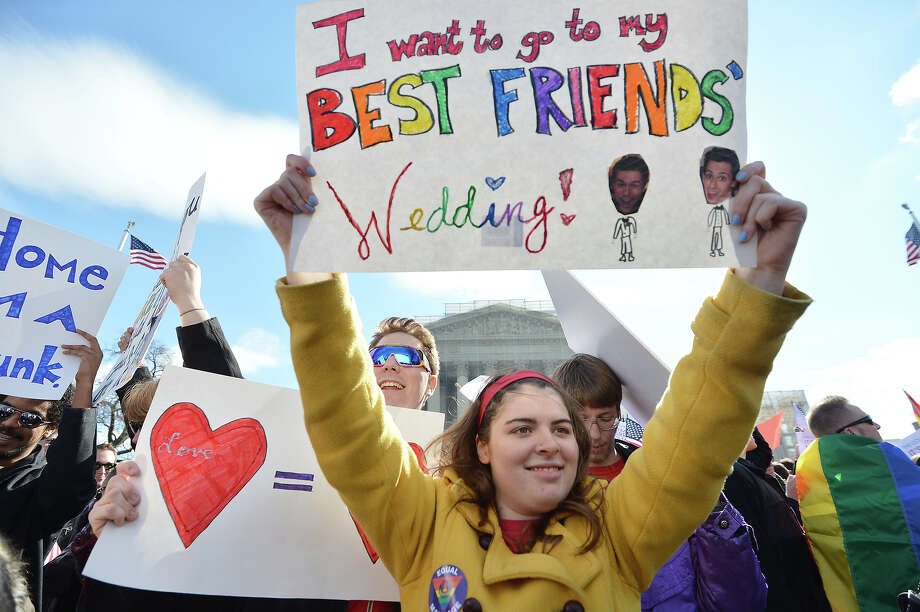 Same-sex marriage supporters demonstrate in front of the Supreme Court on March 27, 2013 in Washington, DC. The rights of married same-sex couples will come under scrutiny at the US Supreme Court on Wednesday in the second of two landmark cases being considered by the top judicial panel. After the nine justices mulled arguments on a California law that outlawed gay marriage on Tuesday, they will take up a challenge to the legality of the Defense of Marriage Act (DOMA). The 1996 law prevents couples who have tied the knot in nine states -- where same-sex marriage is legal -- from enjoying the same federal rights as heterosexual couples. Photo: JEWEL SAMAD, AFP/Getty Images / 2013 AFP
