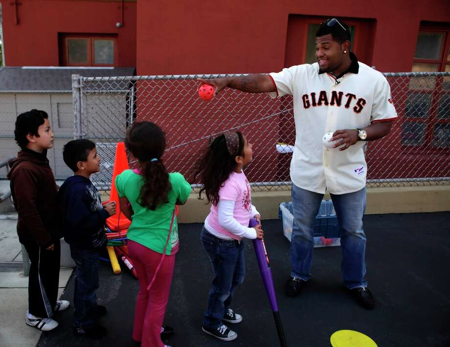Giants' infielder Pablo Sandoval lines up children at the Mission Education Center before pitching to them. The photo was taken in 2010. Photo: Lea Suzuki, The Chronicle / SFC