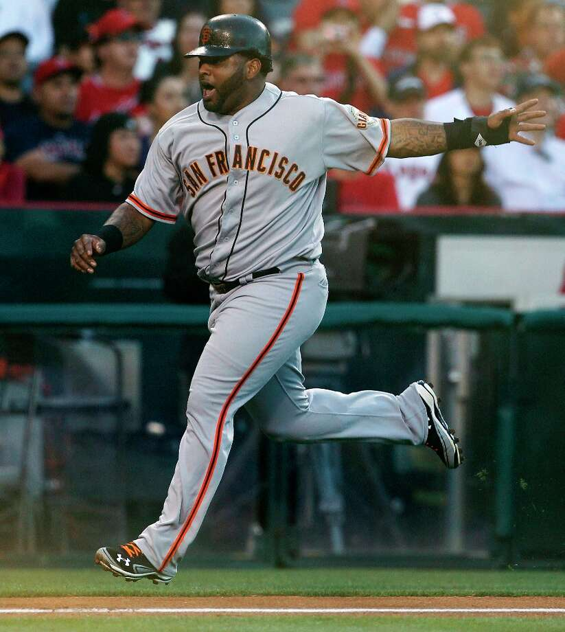 Sandoval reacts as he scores on a two run-triple by Brandon Crawford against the Los Angeles Angels during the second inning of a baseball game in Anaheim, Calif., Monday, June 18, 2012. Photo: Chris Carlson, Associated Press / AP