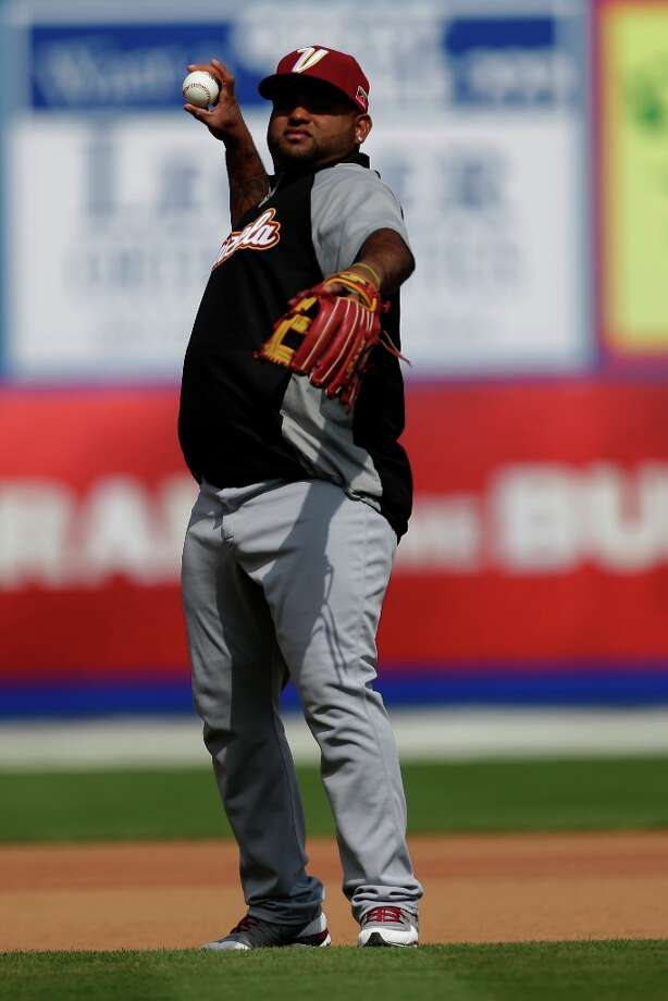 Venezuela infielder Pablo Sandoval throws before an exhibition spring training baseball game against the New York Mets on March 6, 2013. Photo: Julio Cortez, Associated Press / AP