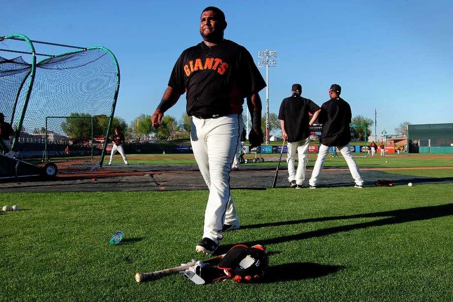 Giants' Pablo Sandoval, (48) takes a break during pre-game workouts as the San Francisco Giants prepare to take on the San Diego Padres at Scottsdale Stadium on Tuesday Mar. 12, 2013, in Scottsdale, Az., in Spring Training action. Photo: Michael Macor, The Chronicle / ONLINE_YES