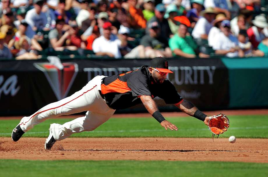 Giants third baseman Pablo Sandoval dives for a ground ball by Japan's Seichi Uchikawa in the third inning, as the San Francisco Giants take on the World Baseball Classic team from Japan in an exhibition game on Thursday Mar. 14, 2013, in Scottsdale, Az., in Spring Training action. Photo: Michael Macor, The Chronicle / ONLINE_YES