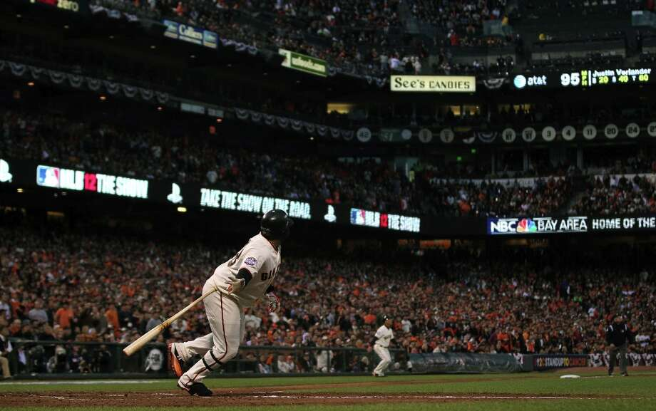 Sandoval watches his solo home run in the first inning go over the wall against Detroit Tigers starting pitcher Justin Verlander in Game One of the World Series Wednesday, October 24, 2012 in San Francisco, California. Photo: Lance Iversen, The Chronicle / ONLINE_YES