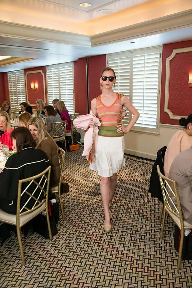 A model walks around the tables during ModeWalk's Spring Fashion Show and Luncheon on March 26, 2013. Photo: Drew Altizer Photography