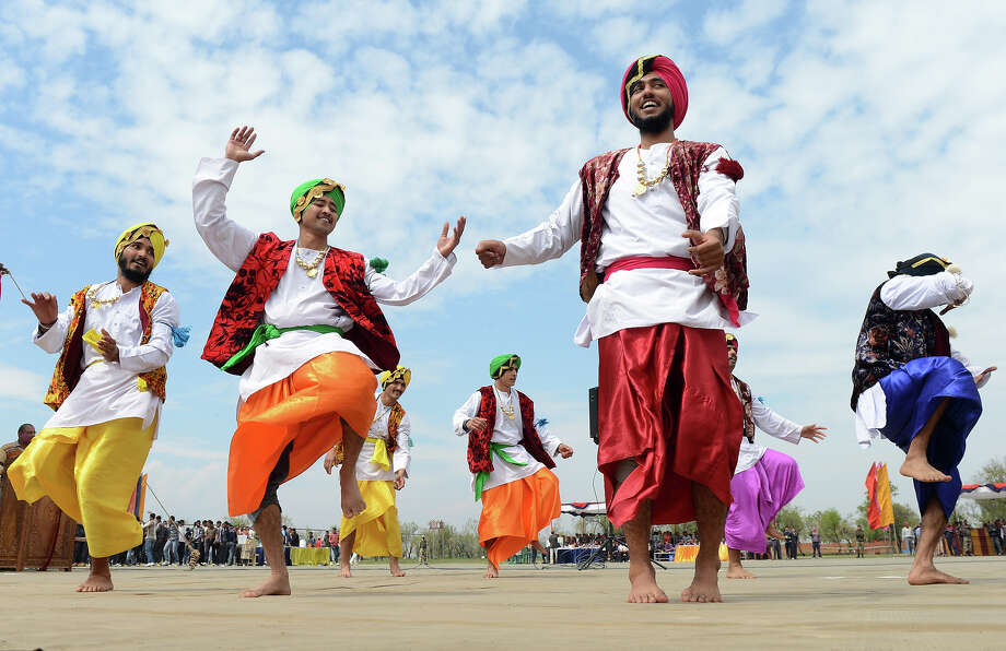 Indian Border Security Force Soldiers (BSF) dance as they celebrate during the Holi festival inside a camp in Srinagar on March 27, 2013.  Holi, also called the Festival of Colors, is a popular Hindu spring festival observed in India at the end of the winter season on the last full moon day of the lunar month. Photo: TAUSEEF MUSTAFA, AFP/Getty Images / 2013 AFP