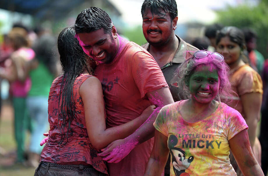 Indian revelers gather during Holi celebrations in Hyderabad on March 27, 2013. Holi, also called the Festival of Colors, is a popular Hindu spring festival observed in India at the end of the winter season on the last full moon day of the lunar month. Photo: NOAH SEELAM, AFP/Getty Images / 2013 AFP