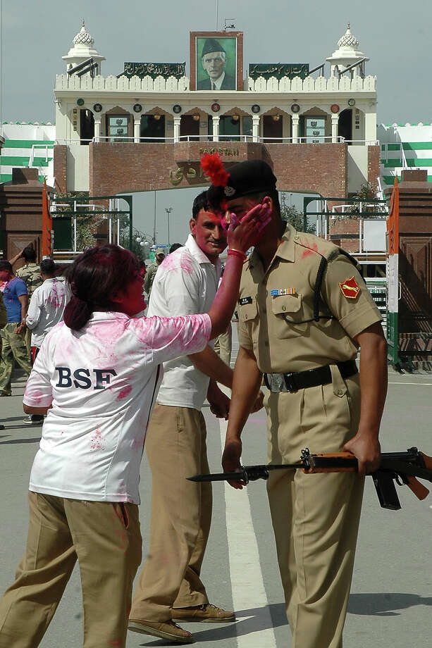 Indian Border Security Force (BSF) personnel play with colored powder during Holi celebrations at the India-Pakistan Wagah Border on March 27, 2013. Holi, the festival of colors, is observed all across the country and signals the onset of Spring. Photo: NARINDER NANU, AFP/Getty Images / 2013 AFP