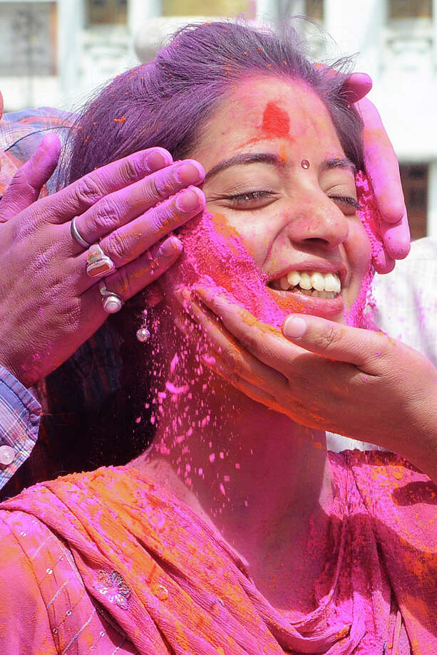 Indian Hindu devotees play with colored powder during Holi festival celebrations in Amritsar on March 27, 2013. 'Holi', the Festival of Colors, is a popular Hindu spring festival observed in India and Nepal at the end of winter season on the last full moon day of the lunar month. Photo: NARINDER NANU, AFP/Getty Images / 2013 AFP