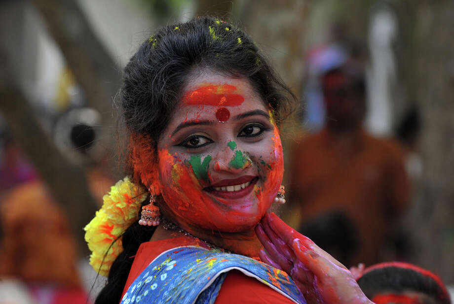 An Indian reveler is covered with colored powder during Holi festival celebrations in Siliguri on March 27, 2013. 'Holi', the Festival of Colors, is a popular Hindu spring festival observed in India and Nepal at the end of winter season on the last full moon day of the lunar month. Photo: DIPTENDU DUTTA, AFP/Getty Images / 2013 AFP