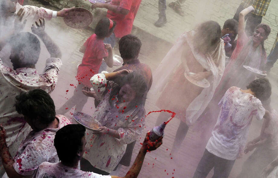 Pakistani Hindus apply colored powder during Holi celebrations in Lahore on March 27, 2013. Holi, or festival of colors, is a popular Hindu spring festival observed at the end of winter season on the last full moon day of the lunar month. Photo: ARIF ALI, AFP/Getty Images / 2013 AFP